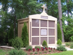 Nine-space mausoleum with large cross and granite inlays in the columns in Hoover, AL