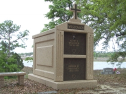 Over-and-under (stack) deluxe mausoleum with fluted columns, a cross and a bench in Ocean Springs, MS