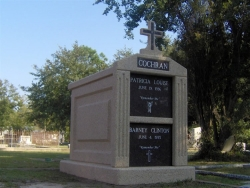 Over-and-under (stack) deluxe mausoleum with fluted columns and a cross in Vancleave, MS
