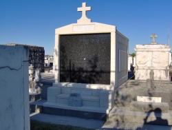 Customized four-space mausoleum with cross, vases on pedestals, step-up trim pieces in New Orleans, LA