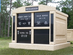 Four-space deluxe mausoleum with granite inlays in the columns in South Port, FL
