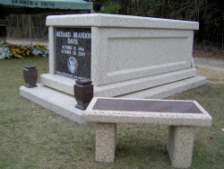 Single basic mausoleum with vases on a foundation/slab with a bench in Dunn, NC