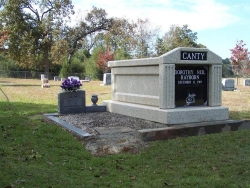 Single deluxe mausoleum with fluted columns in Sumrall, MS