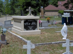 Single basic mausoleum with a cross in Vancleave, MS