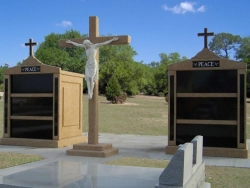 Two six-space tall mausoleums with crosses, granite inlays in the columns, a large cross with the Corpus in Jennings, LA