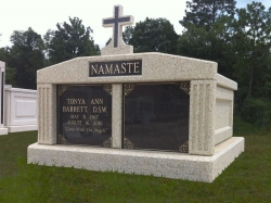 Side-by-side deluxe mausoleum with a cross and fluted columns in Gulfport, MS