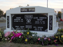 Side-by-side deluxe white mausoleum with engraved granite inlays in the columns in Biloxi, MS