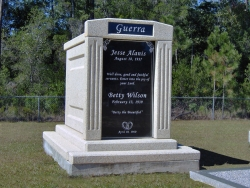 Over-and-under (stack) deluxe mausoleum with fluted columns, step-up trim pieces on a foundation/slab in Vancleave, MS