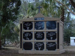 Nine-space mausoleum with large cross and granite inlays in the columns in Crystal River, FL