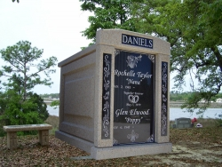 Over-and-under (stack) deluxe mausoleum with engraved granite in the columns in Pascagoula, MS