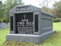 Single deluxe mausoleum in deep gray with granite inlays in the columns in Tallahassee, FL