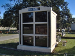 Six-space tall mausoleum with granite inlays in the columns in Biloxi, MS
