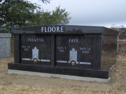 Side-by-side black granite mausoleum on a foundation in Hurley, MS