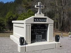 Single deluxe mausoleum with cross, vases and pedestals in Hampton, SC