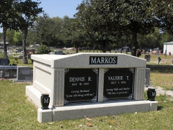Side-by-side deluxe mausoleum with fluted columns and vases on pedestals in Macclenny, FL