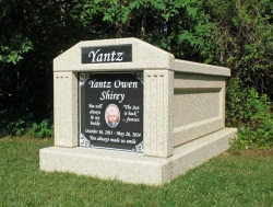 Single deluxe mausoleum with fluted columns and a large porcelain photo plaque in Huntersville, NC