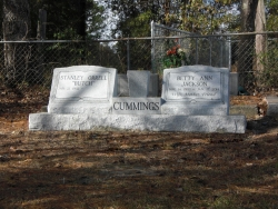 Double granite slant monument on a base with a vase in Vancleave, MS