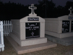 Single deluxe mausoleum with cross and fluted columns on a foundation/slab in Bay St. Louis, MS