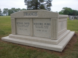 Side-by-side deluxe customized mausoleum with fluted columns and step-up trim pieces in Iselin, NJ