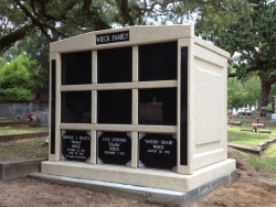 Nine-space mausoleum with granite inlays in the columns on a foundation/slab in Biloxi, MS