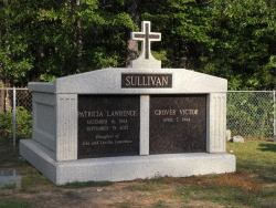 Side-by-side deluxe mausoleum with fluted columns and a cross in Linden, AL