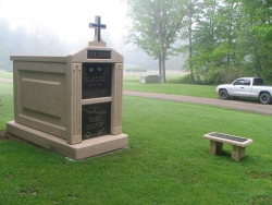 Over-and-under (stack) deluxe mausoleum with fluted columns, a cross and bench in Bradford, PA