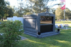 Three-space wide mausoleum deep gray with fluted columns, vases on pedestals, step-up trim pieces in Slidell, LA