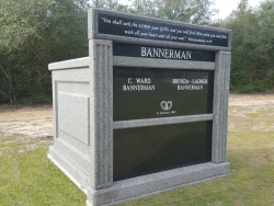 Customized four-space mausoleum light gray with large header on a foundation in Diamondhead, MS