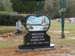 Single black heart-shaped headstone with a color laser etching in Mobile, AL