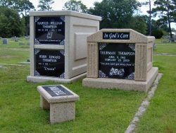 Over-and-under basic mausoleum and a single deluxe mausoleum with fluted columns and a bench in Pascagoula, MS