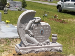 Angel single headstone with a turned vase and a photo plaque in Pascagoula, MS