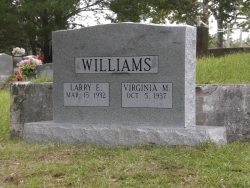 Double granite upright headstone in Ocean Springs, MS