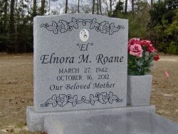 Single granite upright headstone with a photo plaque