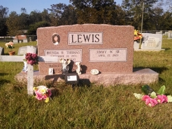 Double upright headstone made of morning rose granite in Saucier, MS
