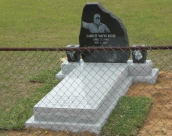 Single jet black granite headstone with 2 vases, a ledger on a concrete slab in Lucedale, MS