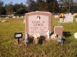Single upright headstone with a vase made of morning rose granite in Saucier, MS