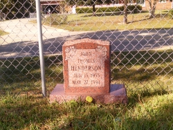 Single upright headstone made of morning rose granite in Saucier, MS