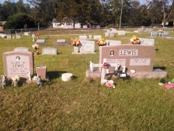 A single morning rose granite headstone and a double morning rose granite headstone in Saucier, MS