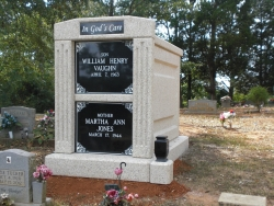 Over-and-under (stack) deluxe white mausoleum with fluted columns  and a vase on a pedestal in Florence, AL