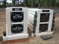 2 over-and-under (stack) deluxe white mausoleums with fluted columns  and a vase on a pedestal in Florence, AL