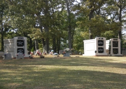 3 over-and-under (stack) deluxe white mausoleums with fluted columns in Florence, AL