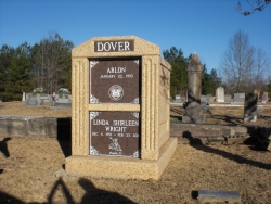 Over-and-under (stack) deluxe mausoleum in brown rock with fluted columns in Carbon Hill, AL