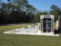 Deluxe over-and-under (stack) white mausoleum with engraved granite inlays in the columns in Pascagoula, MS