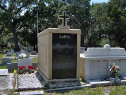 Over-and-under (stack) basic mausoleum with a cross in Biloxi, MS