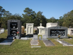 Deluxe over-and-under deep gray mausoleum with fluted columns, and a deluxe side-by-side deep gray mausoleum with fluted columns in Pascagoula, MS
