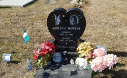 Single black heart-shaped headstone with laser etching in Pascagoula, MS