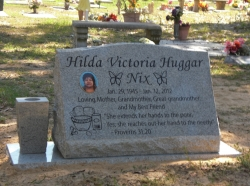 Single granite slant headstone with a vase and all on a base in Biloxi, MS