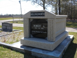 Single deluxe mausoleum with fluted columns on a foundation in Atmore, AL