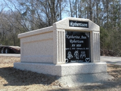 Single deluxe mausoleum with fluted columns in Taylorsville, MS