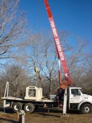 Single deluxe mausoleum on our boom truck prepped to be installed on the cemetery plot in Shelby, NC.